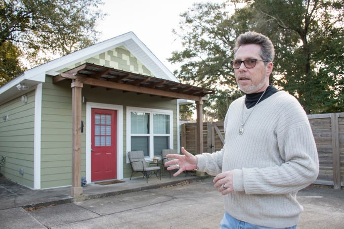 John Rickmon talks about the Accessory Dwelling Unit that he has behind his house in the East Hill neighborhood of Pensacola on Thursday, January 31, 2019.  The stand alone building is a 375 square foot studio apartment that he rents out.