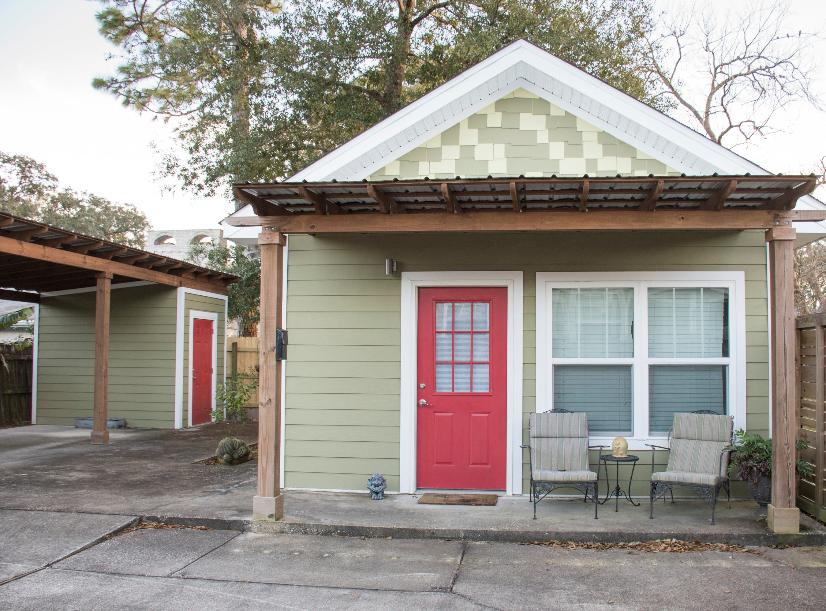 The Rickmon's have an Accessory Dwelling Unit, including its own covered carport, behind their house in the East Hill neighborhood of Pensacola on Thursday, January 31, 2019.  The stand alone building is a 375 square foot studio apartment that they rent out.