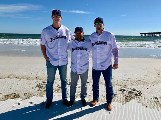 Minnesota Twins pitching prospect Tyler Wells (far left) is joined by new Blue Wahoos manager Ramon Borrego and pitching prospect Devin Smeltzer as they enjoyed Pensacola Beach Thursday afternoon.