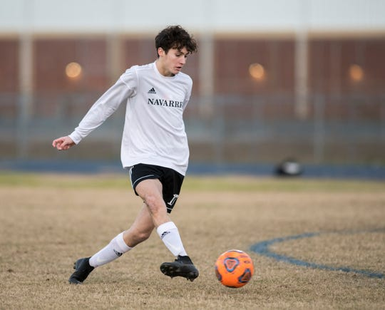Jack Patching (17) passes the ball during the Navarre vs Washington soccer game at Booker T. Washington High School in Pensacola on Wednesday, January 30, 2019.  The Raiders defeated the Wildcats 5 -1.