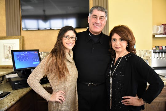 From left, Gabrielle Bahou, Sam Bahou and Grace Bahou, three of the five owners of the Firepit Rotisserie & Grill in Conewago Township.