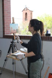 A guest paints an area of Glendale during the Plein Air Competition at the 2018 Glendale Chocolate Affaire.