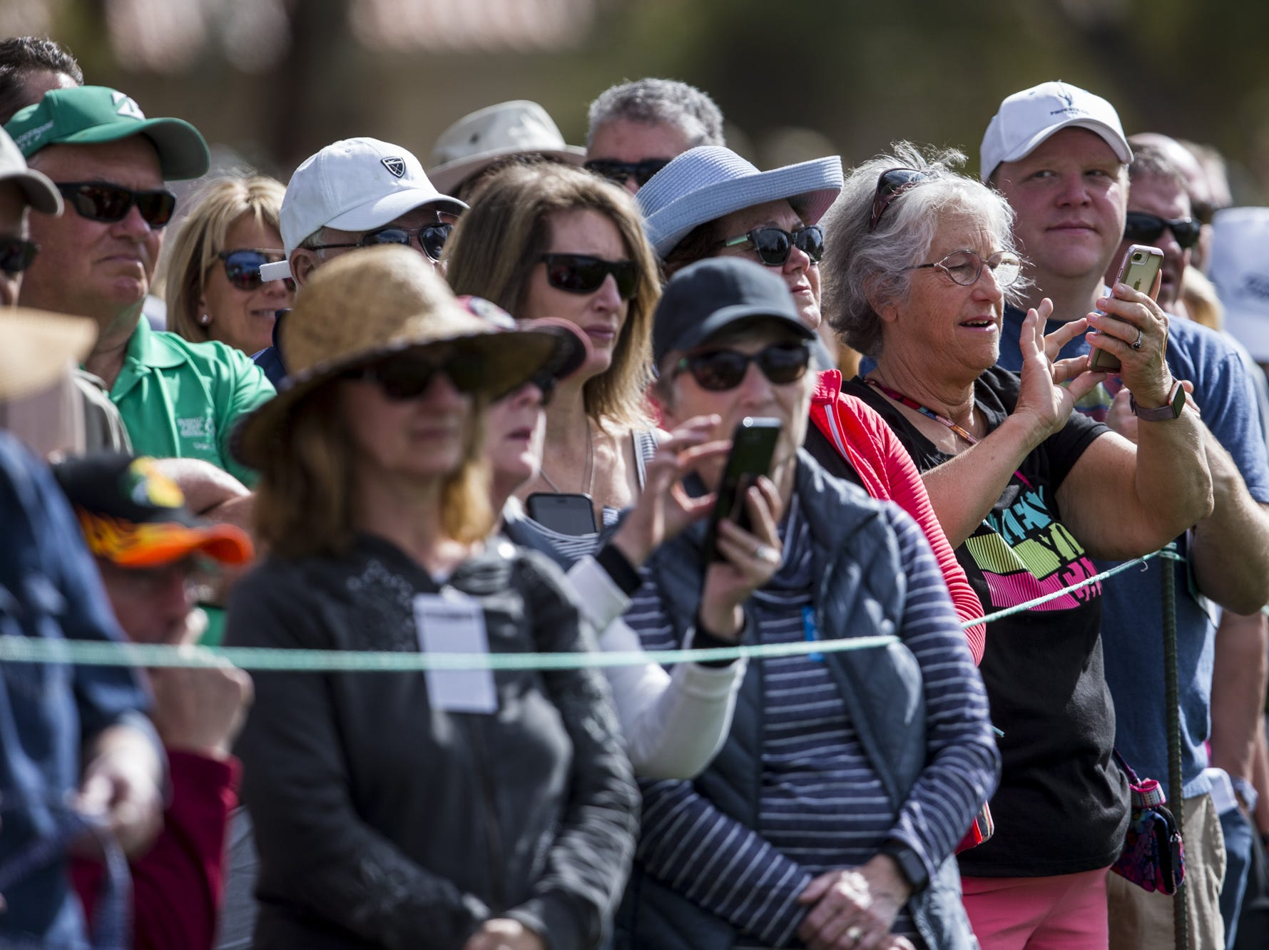 Fans look on from the 1st hole during the opening round of the Waste Management Phoenix Open.