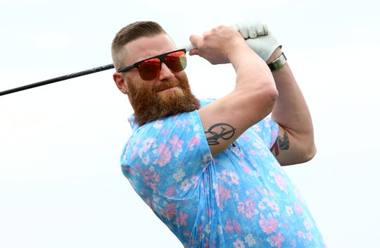 Arizona Diamondbacks pitcher Archie Bradley watches his drive on the first tee during the Annexus Pro-Am on Jan. 30 at the TPC Scottsdale Stadium Course.