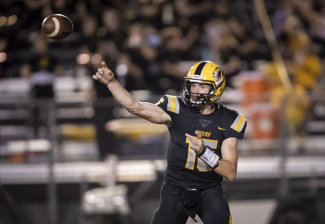 Junior quarterback Will Plummer (15) of the Gilbert Tigers throws the ball against the Notre Dame Prep Saints at Gilbert High School on Friday, August 31, 2018 in Gilbert, Arizona.