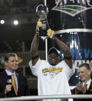 Steelers WR Santonio Holmes holds the Vince Lombardi Trophy after defeating the Cardinals in Super Bowl XLIII at Raymond James Stadium in Tampa, FL February 1, 2009.