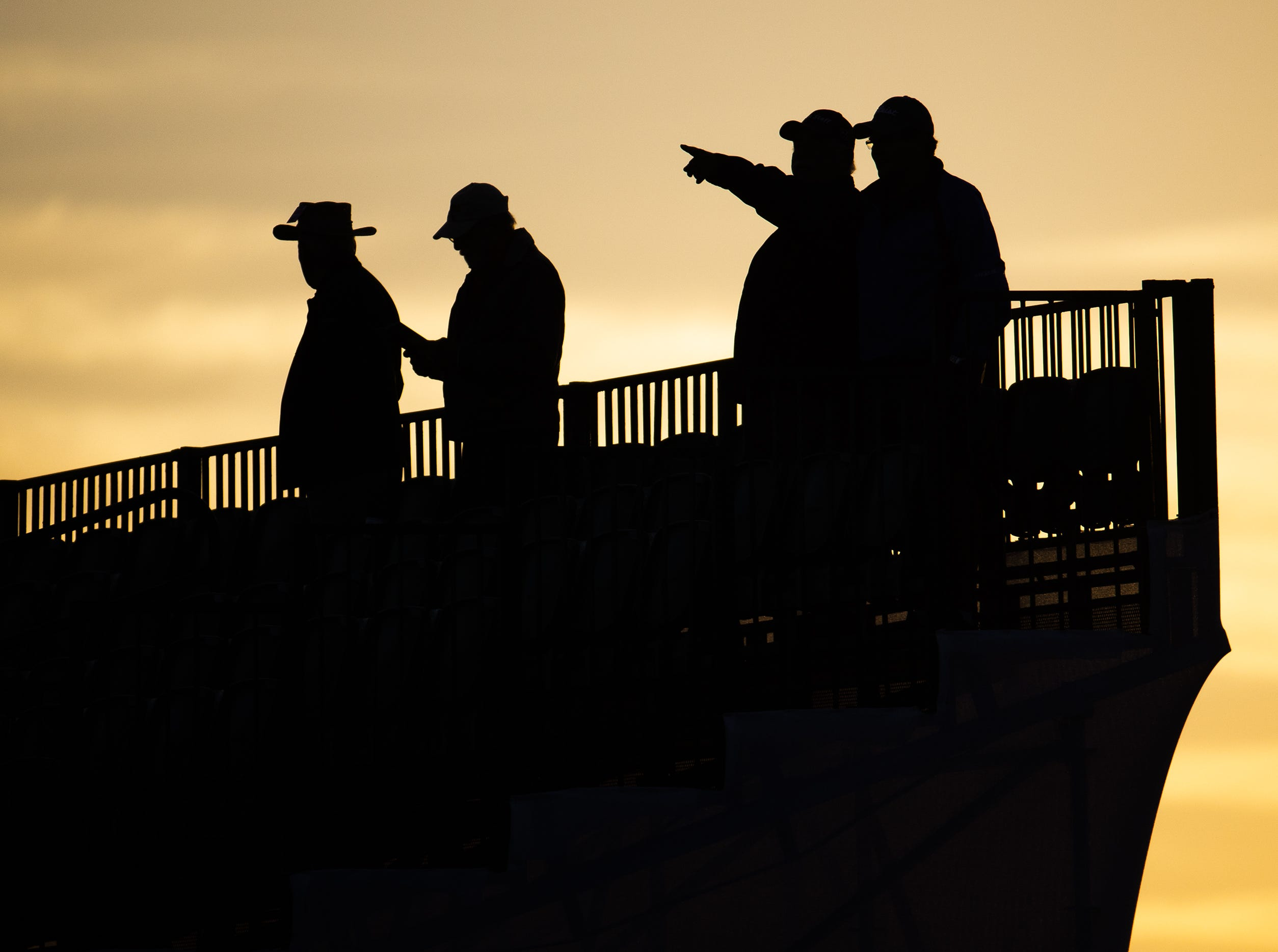 Early bird fans take their place in the stands overlooking the first tee Thursday just before sunrise at the Waste Management Phoenix Open at TPC Scottsdale.