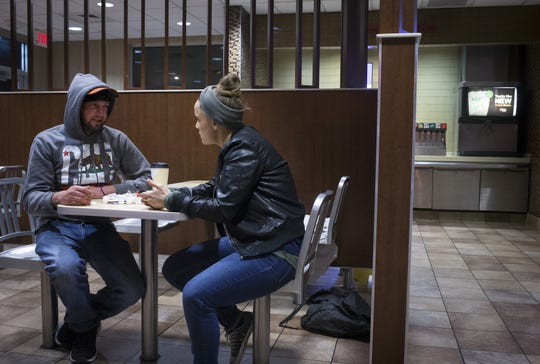 Liz DaCosta, right, of Community Bridges, talks with Samuel Thompson during Maricopa County's annual Point-in-Time count of homelessness, January 22, 2019.