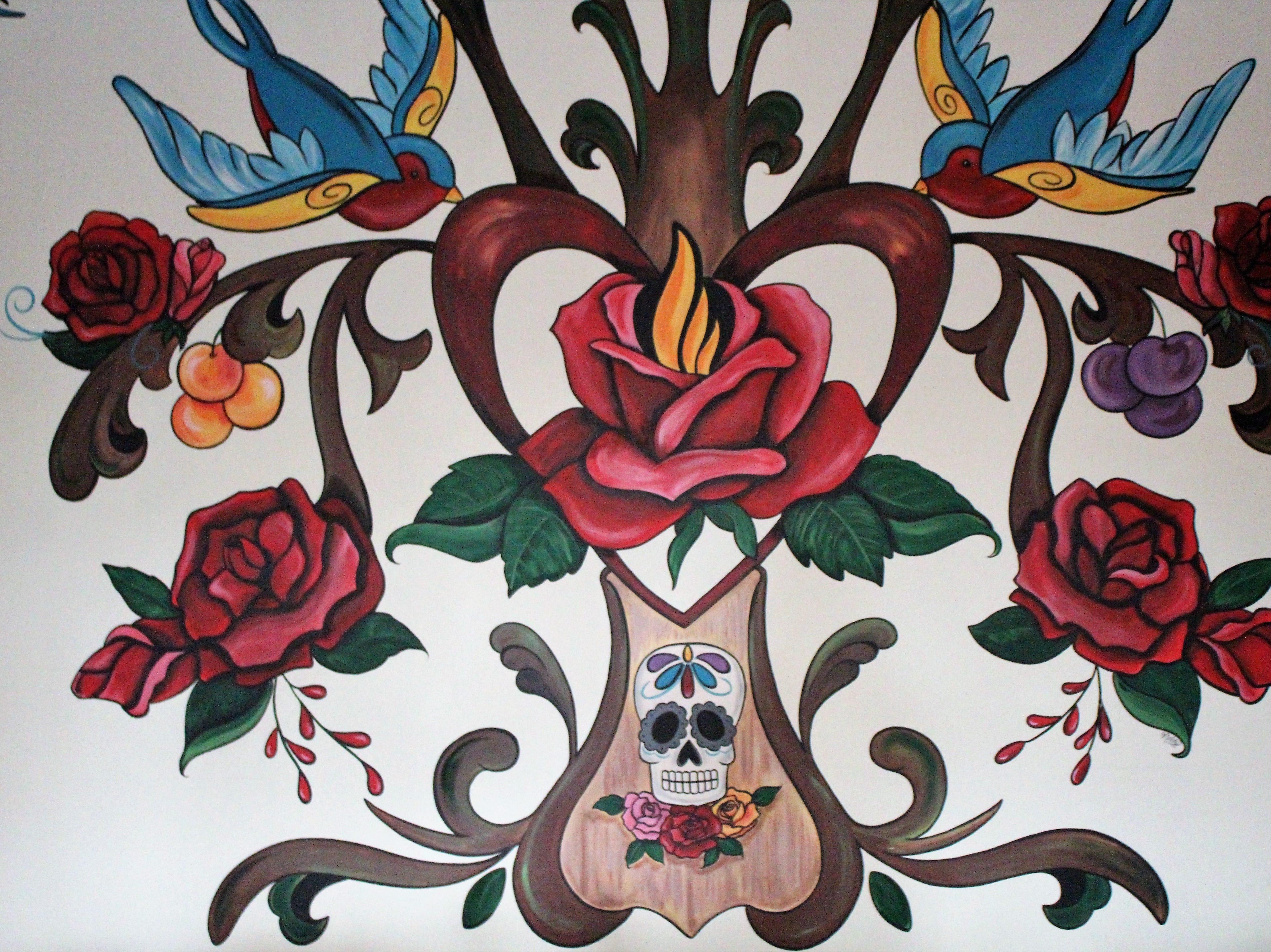 A mural inside the dining room Casa Terra, a vegan fine dining restaurant in Glendale, features the restaurant's logo.