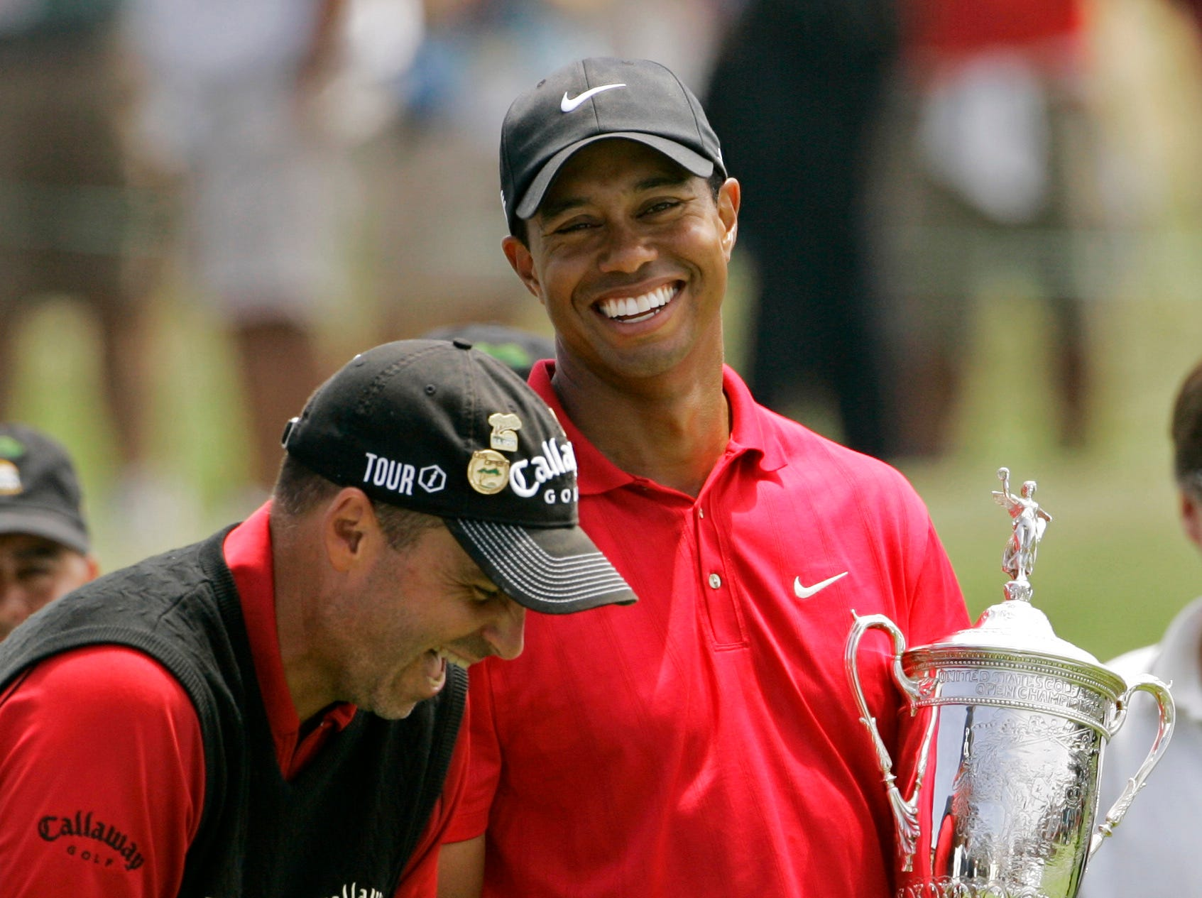 Rocco Mediate laughs with Tiger Woods after Woods' US Open victory following an 18-hole playoff round at Torrey Pines Golf Course in San Diego.  (AP Photo/Charlie Riedel)