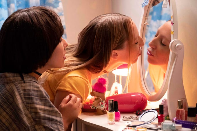 "Maya (Maya Erskine, left) and Anna (Anna Konkle) are spending some time in front of the mirror in ""PEN15."""