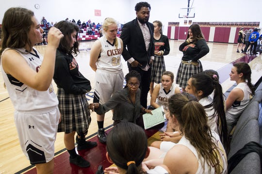 Cicero Prep Academy coach Catrina Warren gives her team instructions during a timeout against Phoenix County Day during their game in Scottsdale, Tues, Jan. 29, 2019.