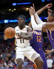 How would Jrue Holiday look in a Suns jersey?