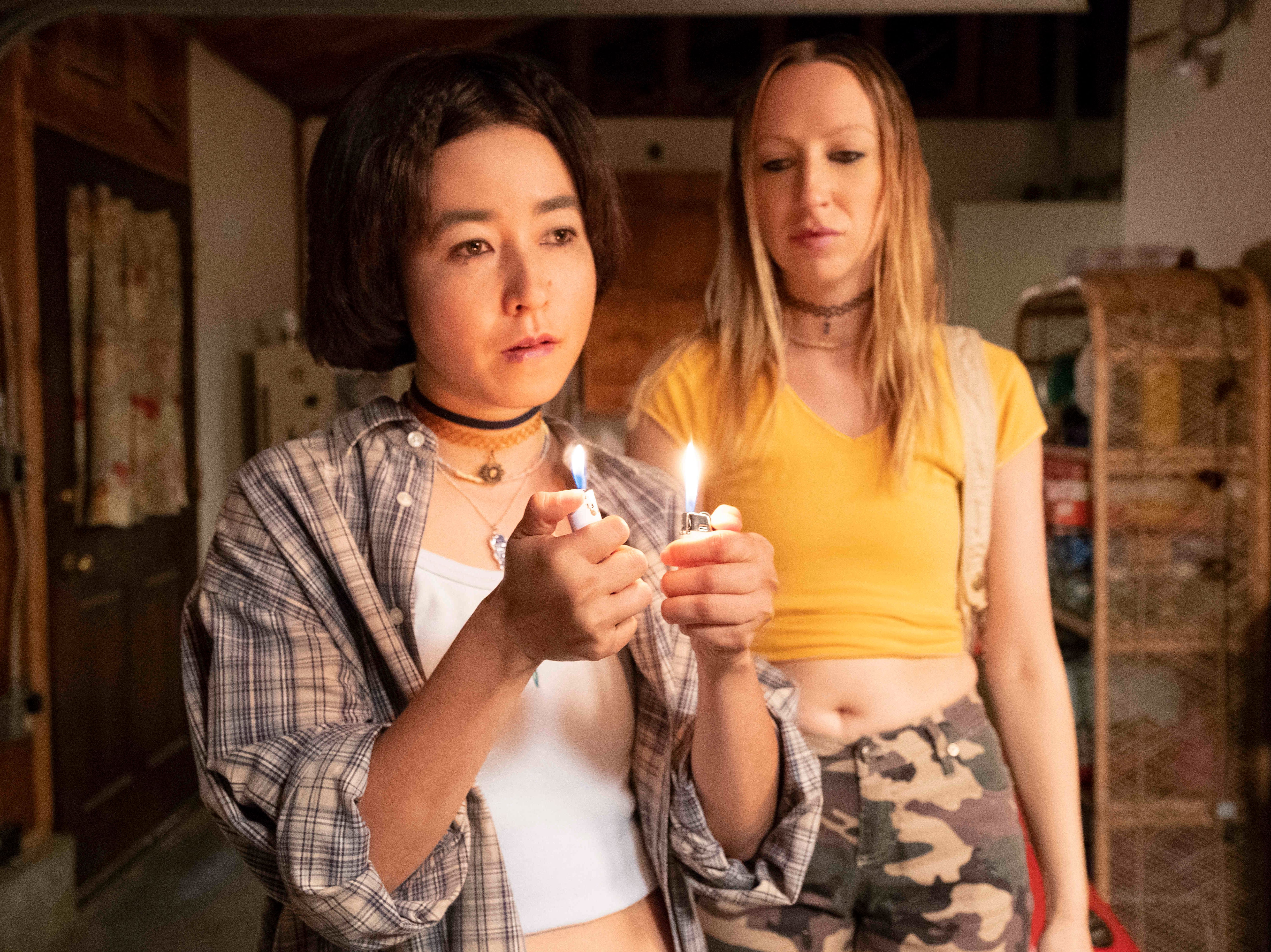 "Maya (Maya Erskine, left) and Anna (Anna Konkle) become fascinated with the mature girls in their class who smoke in ""PEN15."""