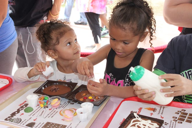 Kids make chocolate pizzas at the Cerreta's booth in Murphy Park during the 2018 Glendale Chocolate Affaire.