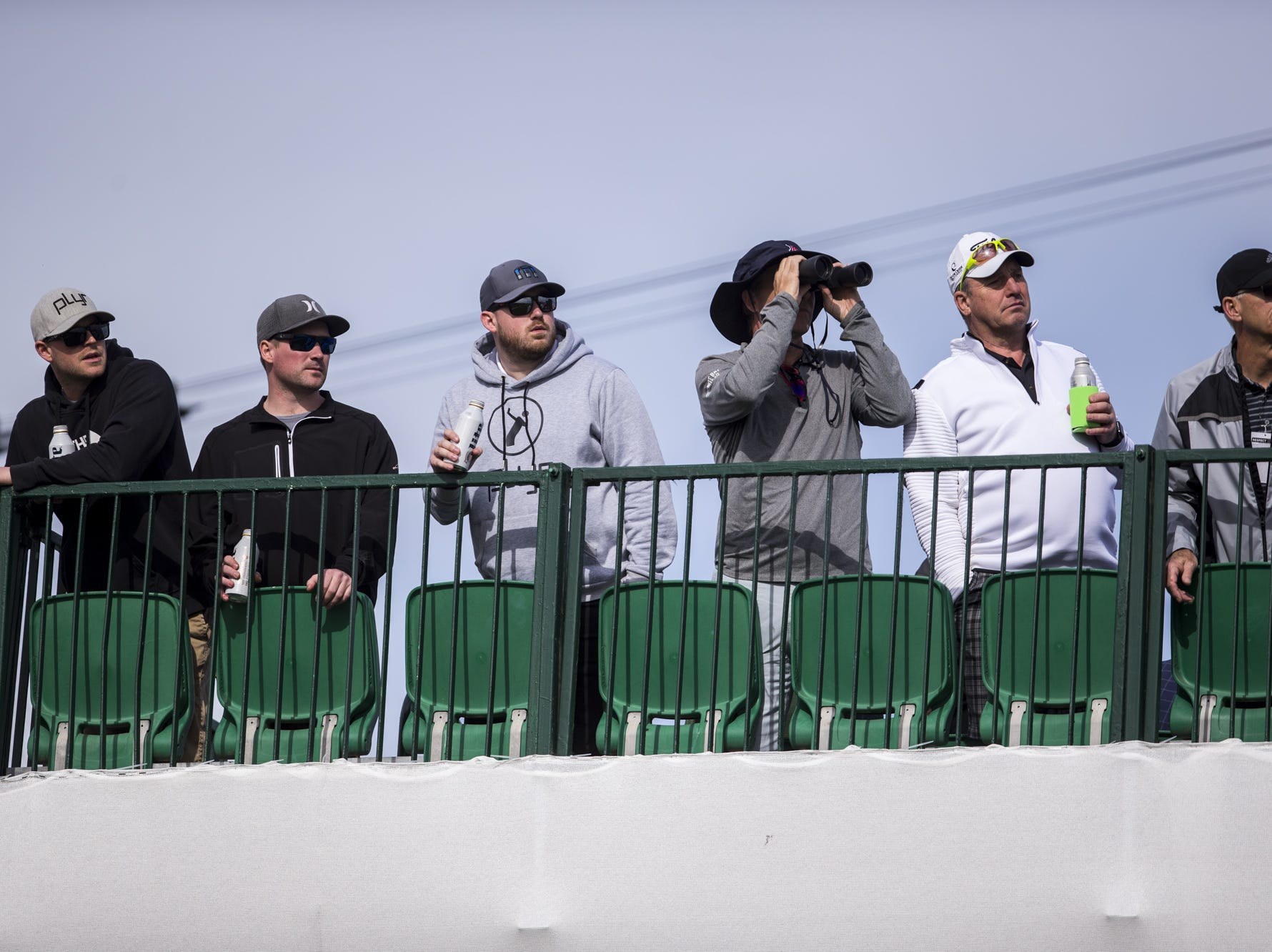 Fans watch a drive on the 17th hole during the first round of the Waste Management Phoenix Open at TPC Scottsdale.