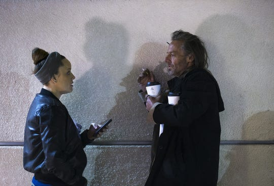 Liz daCosta (left) talks with a man during the county's annual Point-in-Time count of people who are homeless, January 22, 2019.