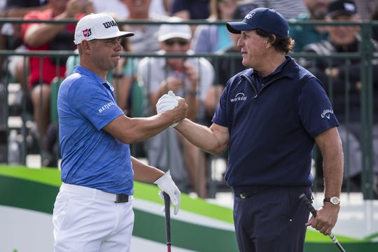 Gary Woodland and Phil Mickelson greet each other at the 1st hole of the Waste Management Phoenix Open on Thursday.
