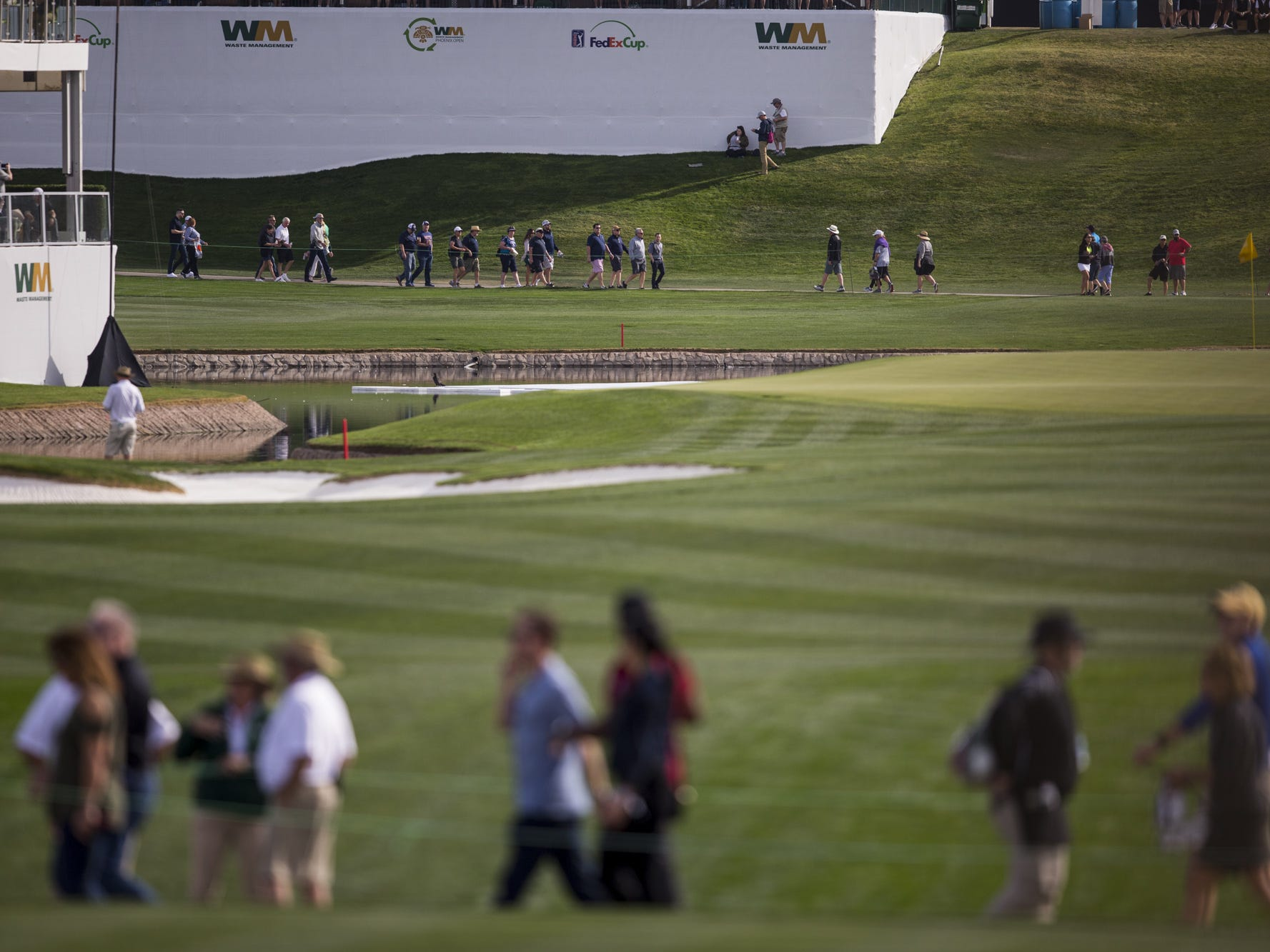 Fans walk the course during the first round of the Waste Management Phoenix Open.