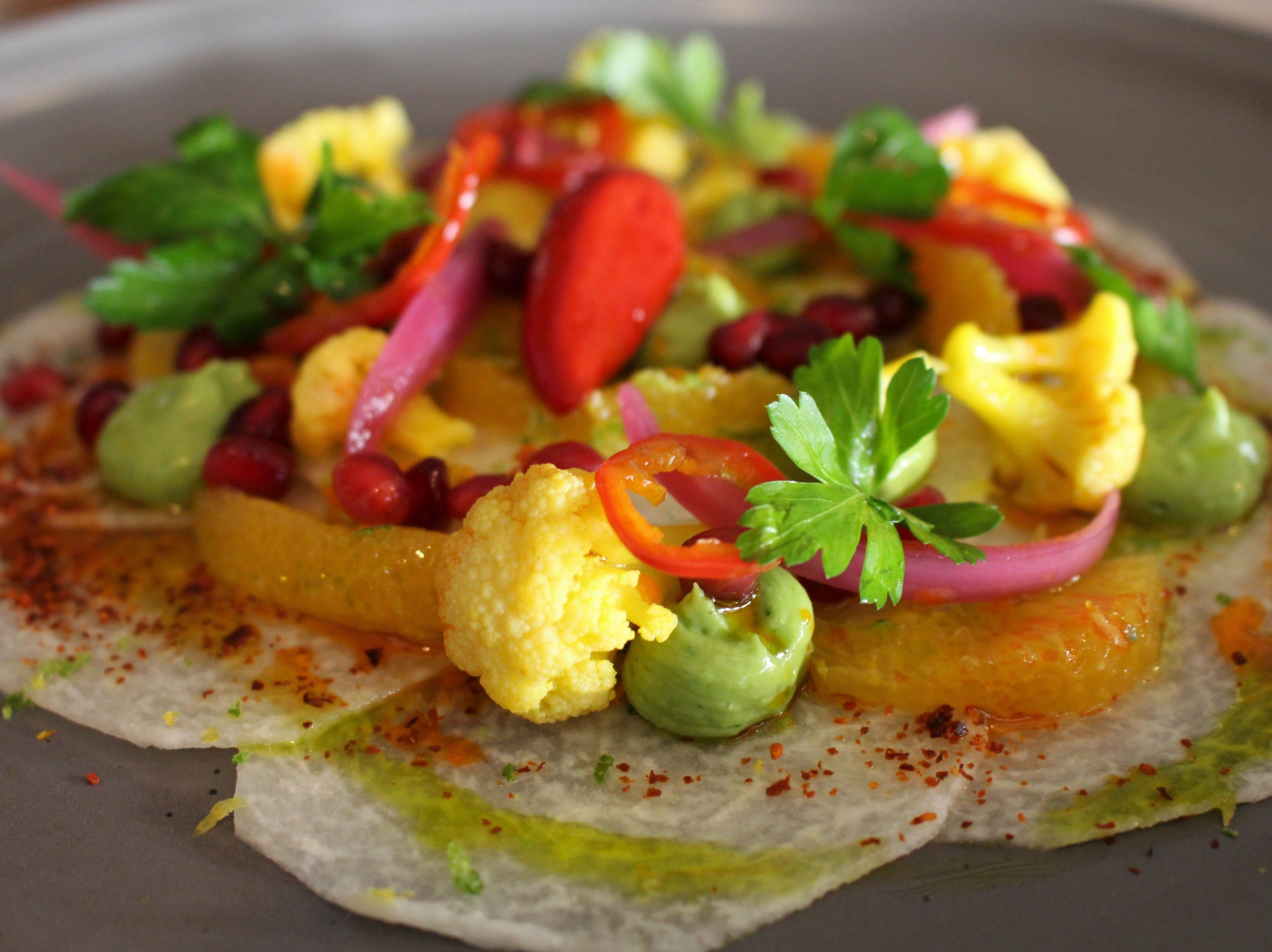 Jicama Crudo with avocado puree and orange segments from Casa Terra, a vegan fine dining restaurant in Glendale.
