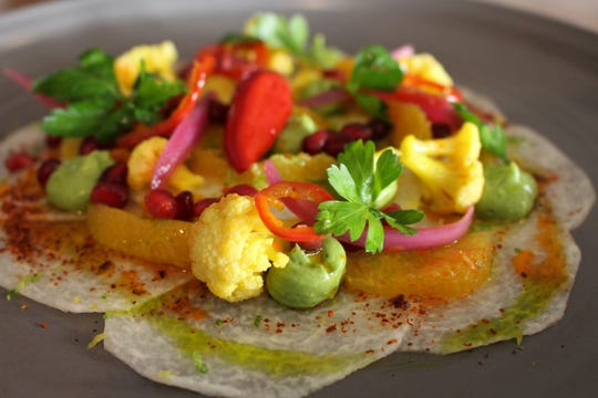 Jicama crudo with avocado puree and orange segments from Casa Terra, a vegan fine-dining restaurant in Glendale.