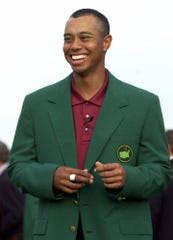 Tiger Woods smiles after receiving his Masters green jacket after winning the 2001 Masters golf tournament at the Augusta National Golf Club. (AP Photo/Amy Sancetta)