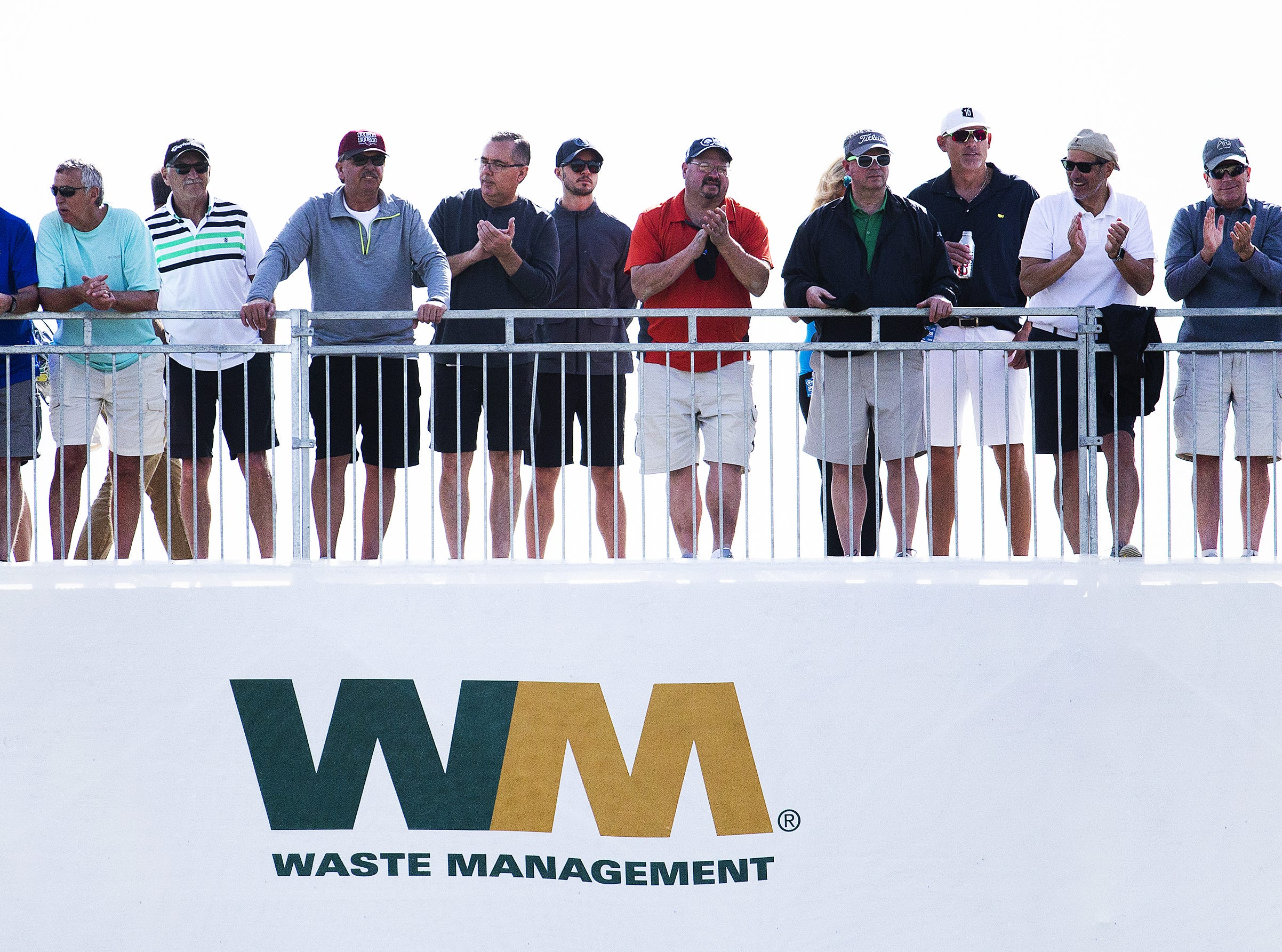 Fans look down on the 9th hole during the first round of the Waste Management Phoenix Open.