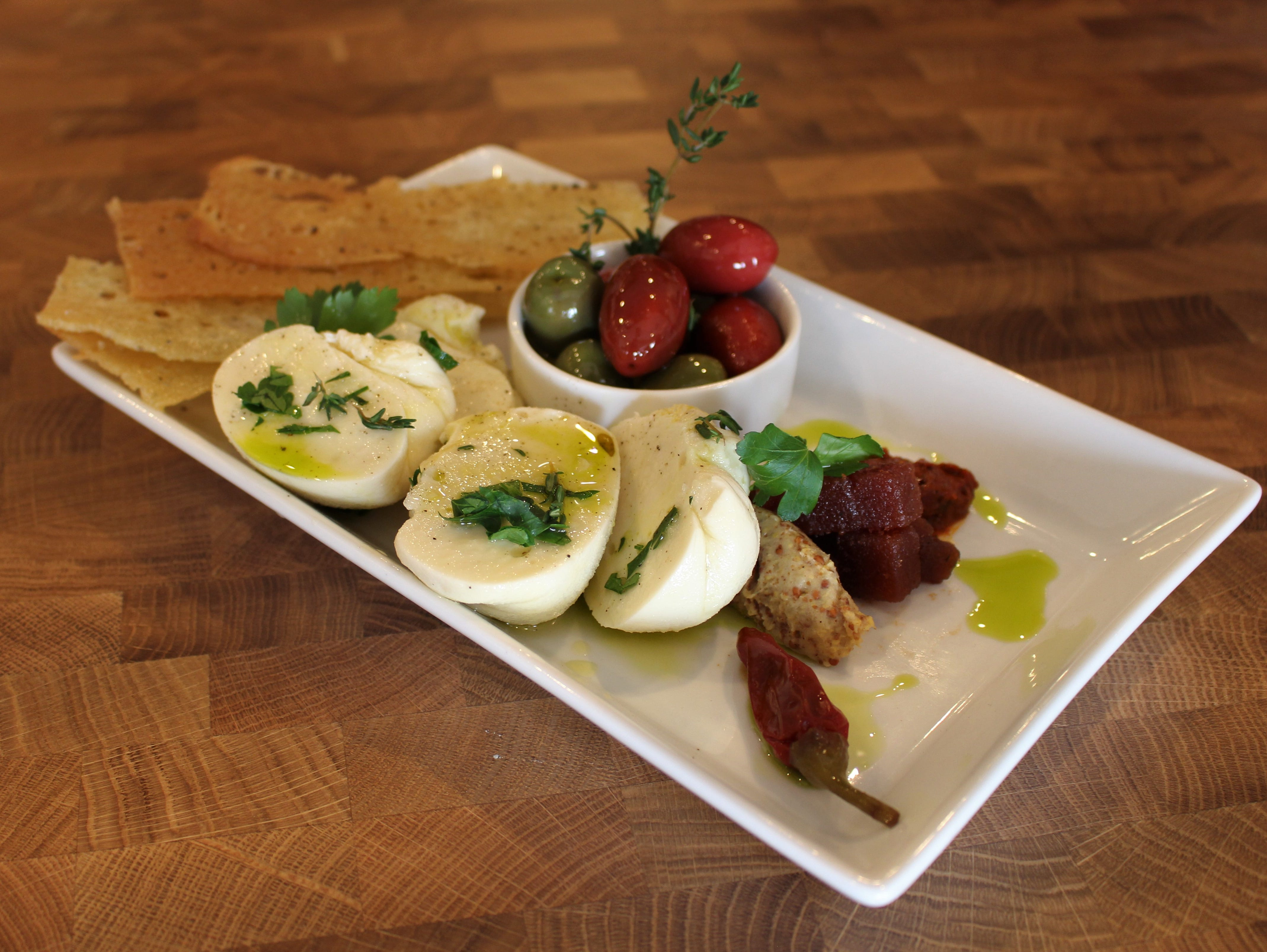 "Casa Terra, a vegan fine dining restaurant in Glendale, serves housemade cheese including ""mozzarella"" made from almond milk."