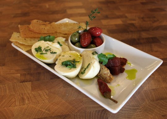 """Casa Terra, a vegan fine-dining restaurant in Glendale, serves house-made cheese including """"mozzarella"""" made from almond milk."""