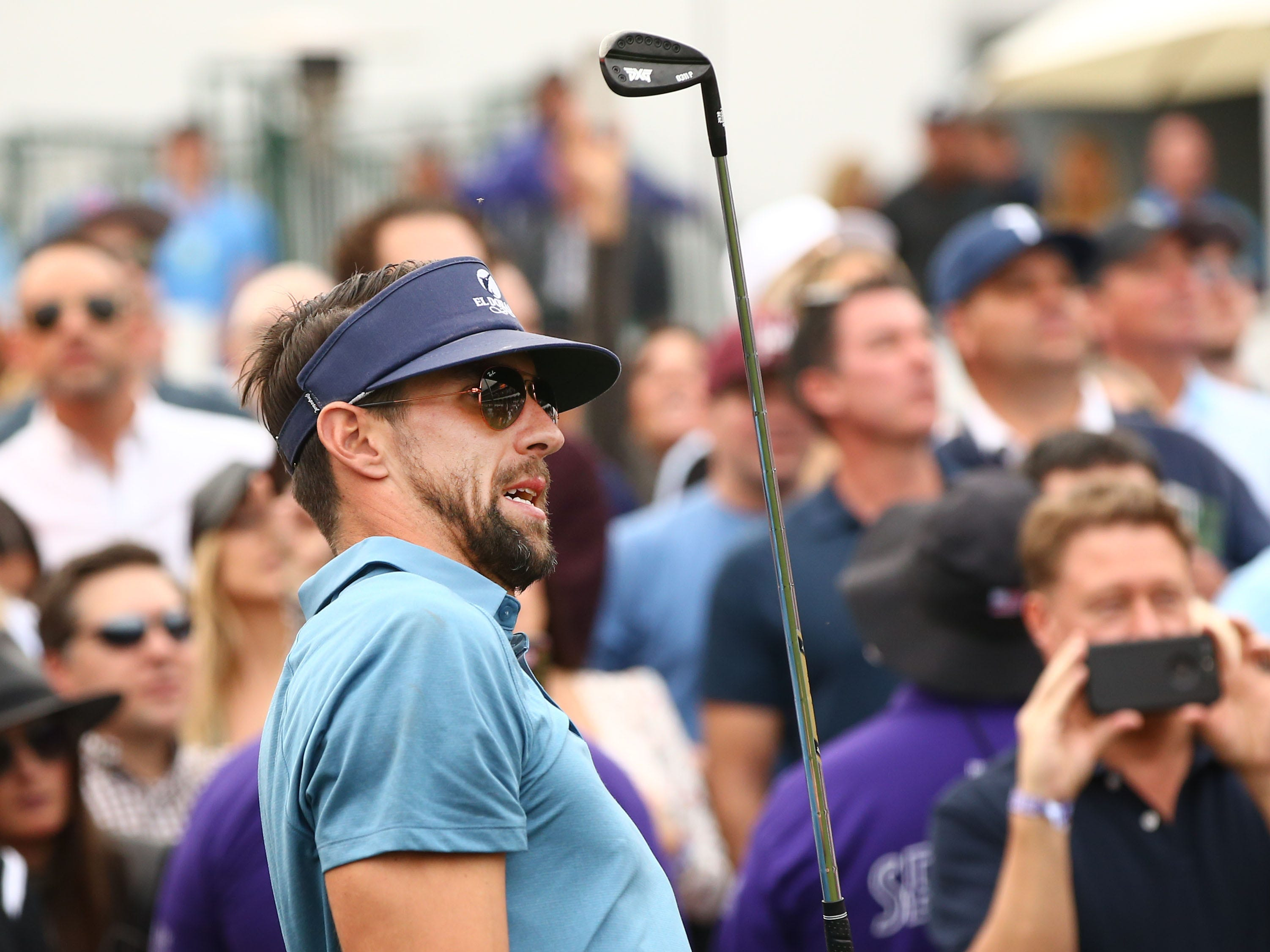 Michael Phelps reacts to his shot during the Phoenix Suns Charities Shot at Glory hole-in-one contest at the 16th hole on Jan. 30 at the TPC Scottsdale Stadium Course.