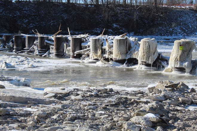 Snow and ice coat the ice control pillars on Thursday where the Ballville Dam used to stand, as Fremont and surrounding areas weathered a second straight day of subzero temperatures and dangerous wind chill levels.