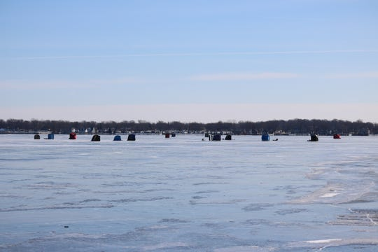 Dedicated anglers brave wind chills reportedly as low as 30-below zero to do some ice fishing at East Harbor State Park on Thursday.