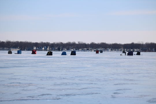 Dedicated anglers brave wind chills as low as 30-below zero to do some ice fishing at East Harbor State Park.