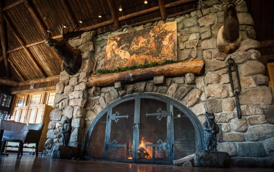 Restaurant 1915's floor-to-ceiling stone fireplace at Bear Mountain Inn.