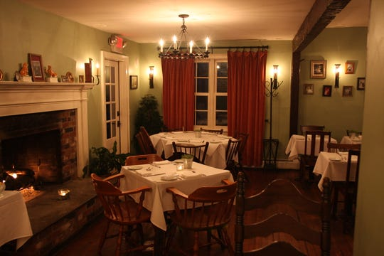 Dining at Serevan in Amenia features a cozy fireplace.