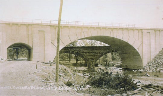 The new concrete bridge at Scotland in 1909, the two arch stone bridge would be torn down shortly after this picture was taken.