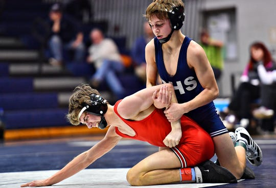 Dallastown's Caden Dobbins, right, wrestles Cumberland Valley's Noah Groelly in the 106 pound weight class during District 3, Class 3A wrestling action at Dallastown Area High School in York Township, Wednesday, Jan. 30, 2019. Dawn J. Sagert photo