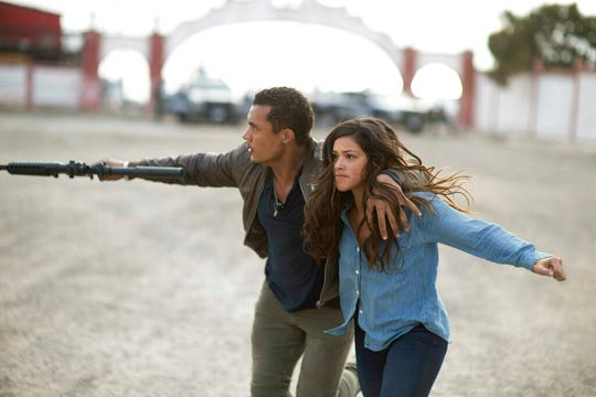 "Ismael Cruz, left, and Gina Rodri­guez  star in ""Miss Bala."" The movie is playing at Regal West Manchester Stadium 13, Frank Theatres Queensgate Stadium 13 and R/C Hanover Movies."