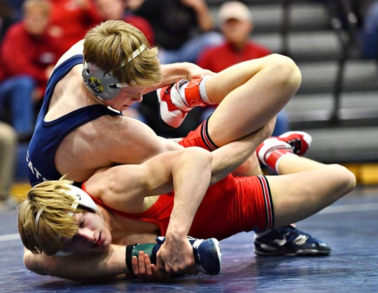 Dallastown's Sam Druck, top, wrestles Cumberland Valley's Cade Reichart in the 145 pound weight class during District 3, Class 3A wrestling action at Dallastown Area High School in York Township, Wednesday, Jan. 30, 2019. Dawn J. Sagert photo