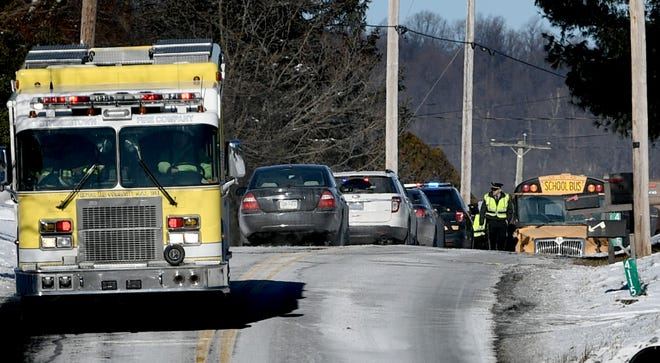 Emergency vehicles respond to the scene of a fatal accident involving involving a passenger car and a loaded school bus on Lewisberry Road in Conewago Township Thursday, Jan. 31, 2019. No students on the bus were hurt according to police. Bill Kalina photo