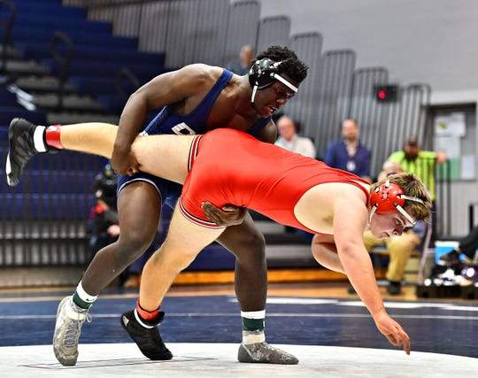 Dallastown's Jamal Brandon, back, wrestles Cumberland Valley's Connor Mundis in the 220 pound weight class during District 3, Class 3A wrestling action at Dallastown Area High School in York Township, Wednesday, Jan. 30, 2019. Dawn J. Sagert photo