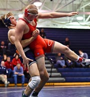 Dallastown's Jarrett Feeney, left, wrestles Cumberland Valley's Dontey Rogan in the 195 pound weight class during District 3, Class 3A wrestling action at Dallastown Area High School in York Township, Wednesday, Jan. 30, 2019. Dawn J. Sagert photo