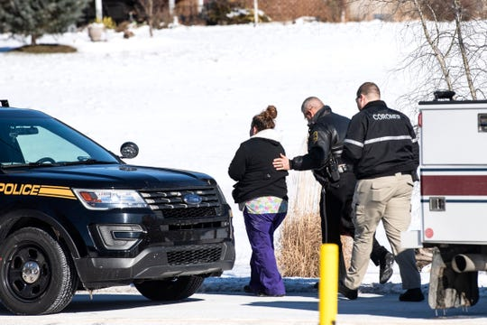 A Northern York County Regional Police Officer comforts a women who arrived at the scene of a fatal crash on Thursday morning in Conewago Township. The crash involved a station wagon and a school bus. No students were injured in the crash.