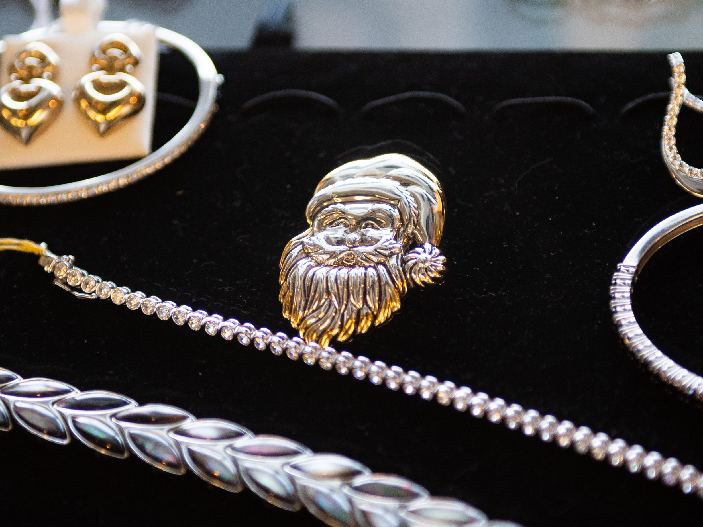 Holiday themed jewelry sits on display at Botterbusch Jewelry, January 30, 2019.