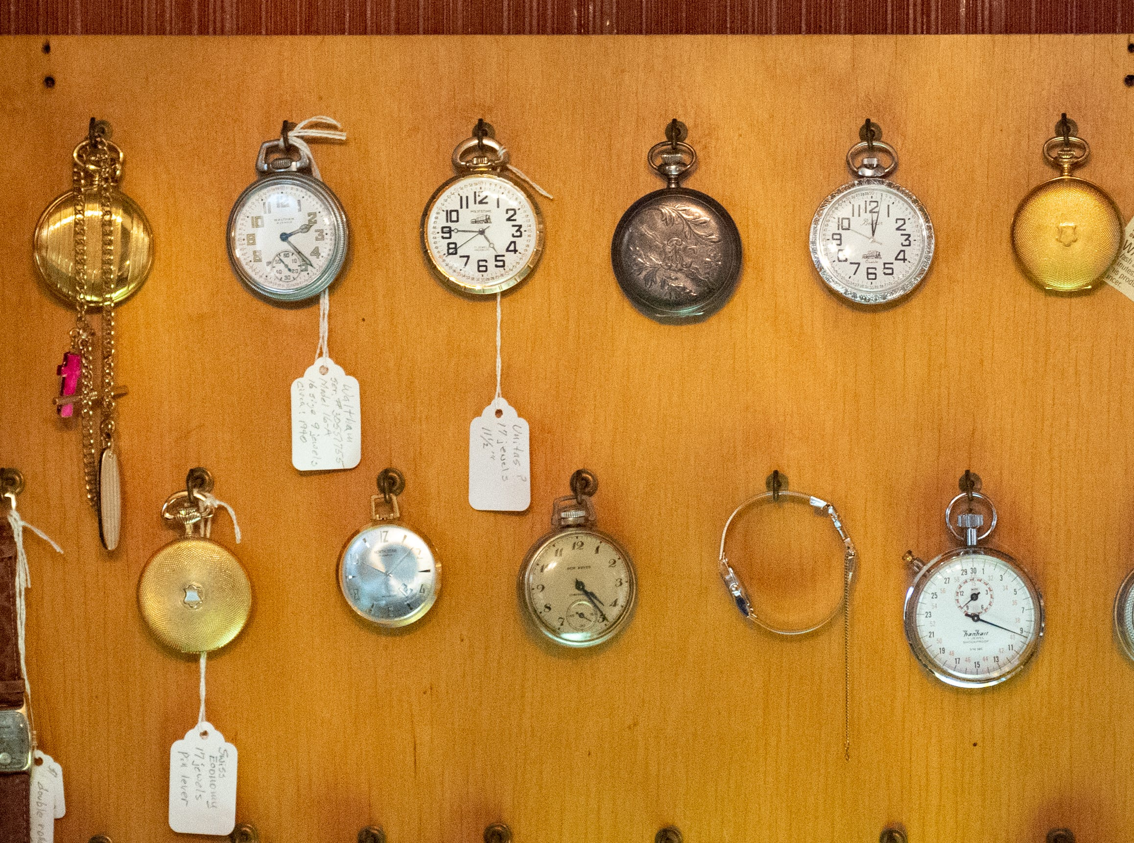 Ronald Botterbusch hangs some of his own favorite watches up in front of his desk, January 30, 2019.