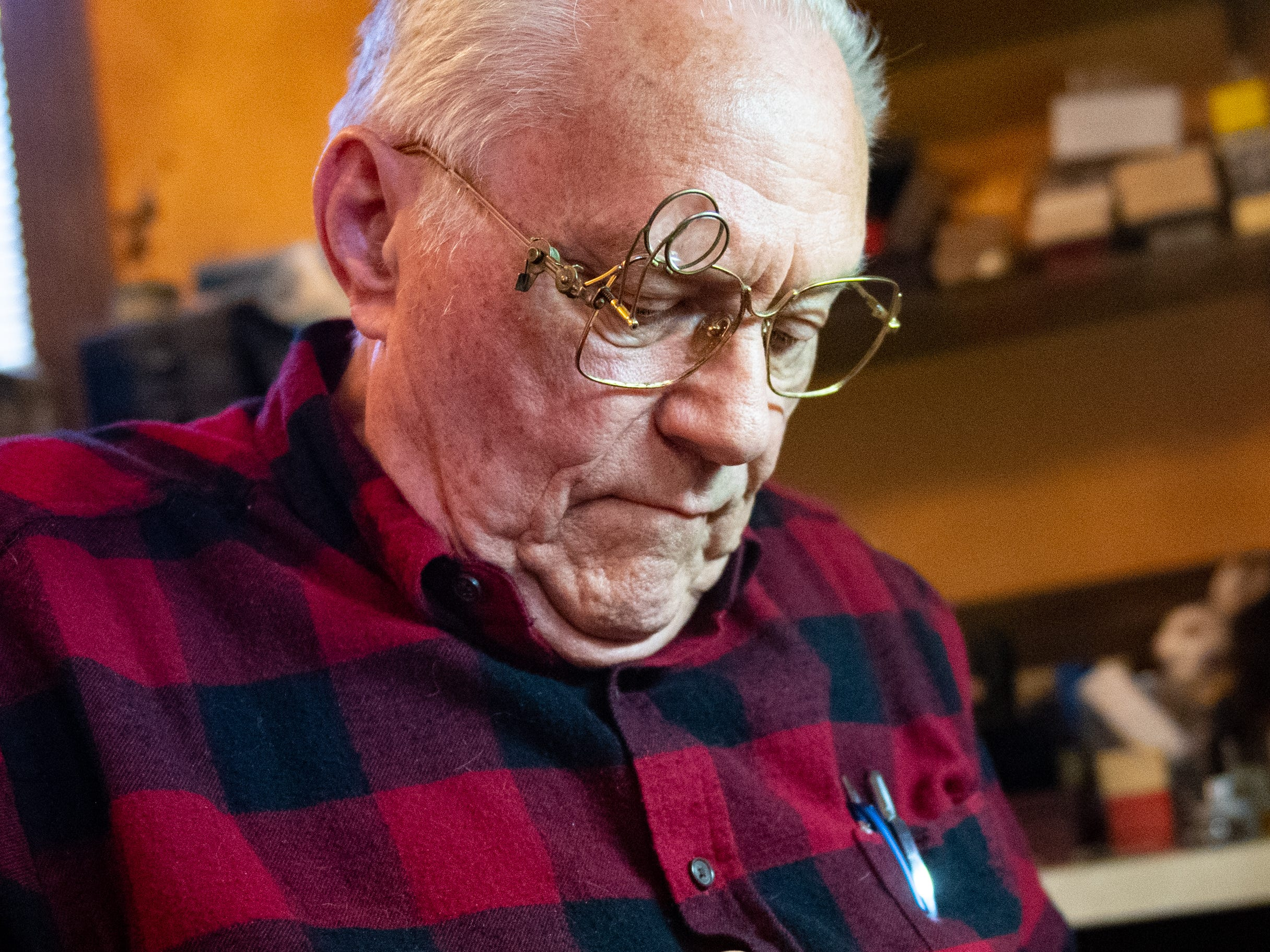 Ronald 'Ron' Botterbusch opens the back of a watch in his Dover store of 53 years. Thursday was the final day for the business. He ran Botterbusch Jewelry along with his wife, Norma.
