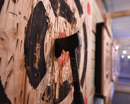 A hatchet sits just outside the bullseye at Stumpy's Hatchet House in Lancaster. A Stumpy's Hatchet House is coming to a Delran shopping center in the spring.