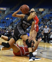 Nevada's Terae Briggs runs over UNLV's Paris Strawther as she drives to the basket in Wednesday's game at Lawor Events Center. Nevada beat UNLV 62-70.
