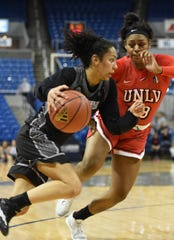 Nevada's Jade Redman drives to the basket with UNLV's Jordyn Bell defending during Wednesday's game at Lawor Events Center . Nevada beat UNLV 62-70.