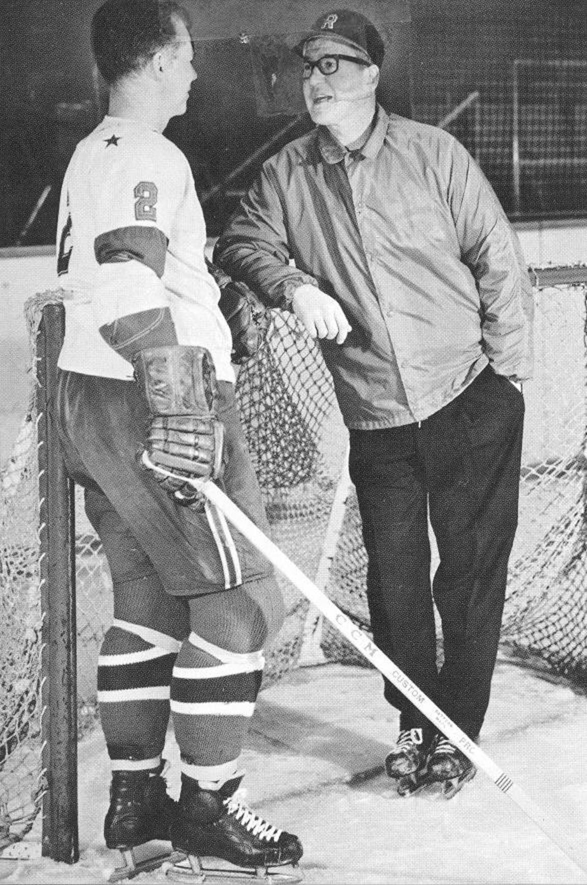 Defenseman Don Cherry, left, chats with Rochester Americans coach Joe Crozier in the 1960s.